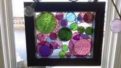 my 3rd stained glass circles project hangs in the bedroom