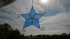 the blue stained glass star i made my mom for mother's day