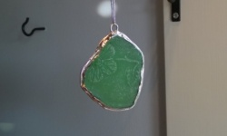 i turned christyne's piece of beach glass into a necklace