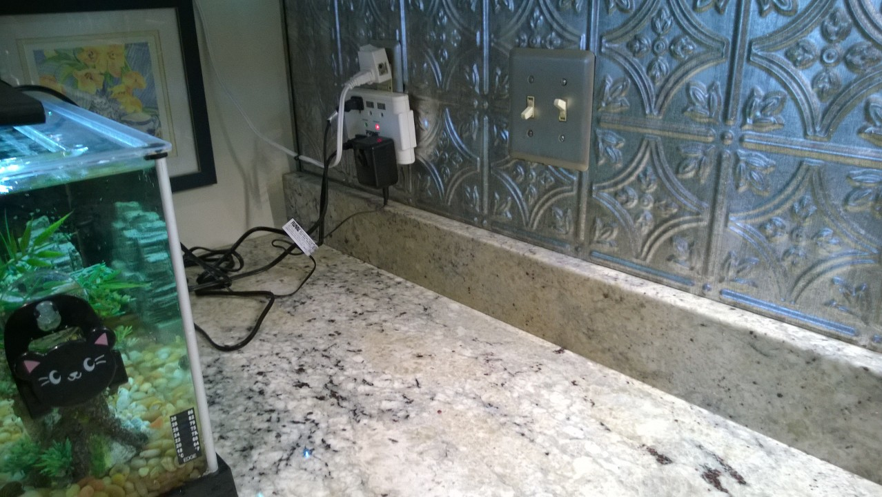 i m a caulking dumbass orbited by nine dark moons i moved everything away from the kitchen backsplash washed it thoroughly and used frog tape to mark my first area