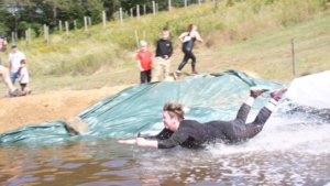 me completing the funnest obstacle at the 5k muddy leprechaun mud run - marini farm, ispwich!