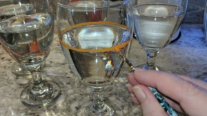 "i carefully painted ""1 cup"" lines around each of our 6 wine glasses"