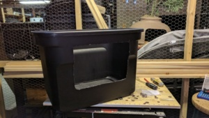 i cut a hole in the front of this black storage bin create a diy litterbox