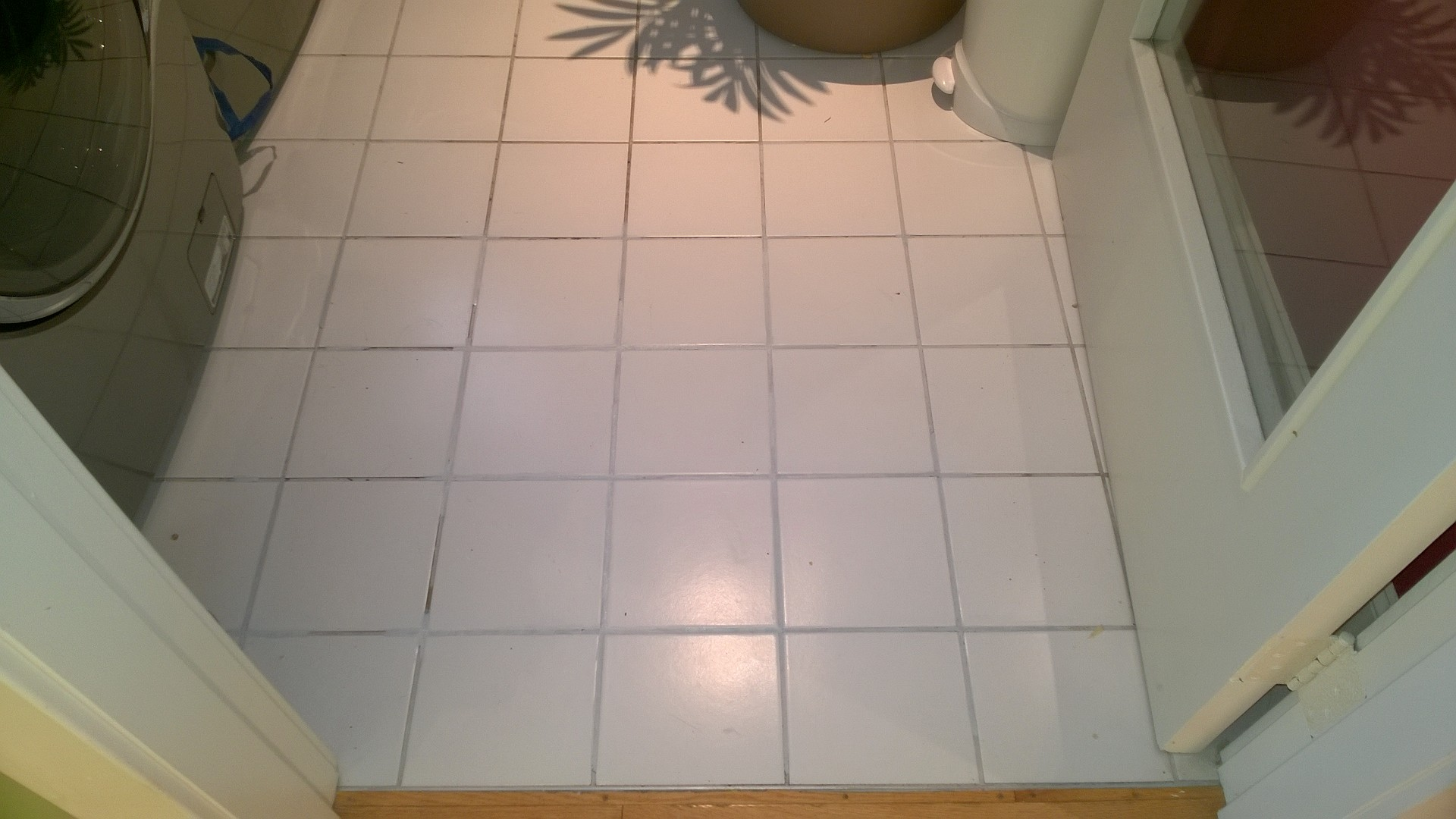 i replaced the cracked tile in the master bathroom using polyblend grout renew to re-hue the old dark grout in the laundry room