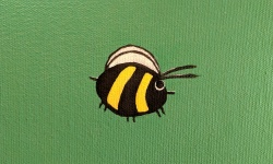 closeup of the bumble bee i painted on the chameleon mural