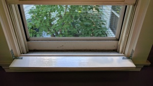 i attached the new front entrance hall windowsill to the frame with brackets