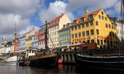painted buildings and houseboats at nyhavn waterfront, copenhagen