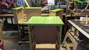i put 4 coats of high gloss bm rosemary green on jim's cupboard