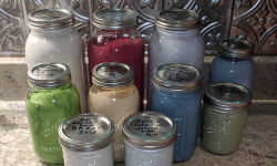 the mason ball jars look so pretty with colored paint in them