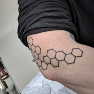 my arm tattoo, a carbon net or grid of carbon molecules