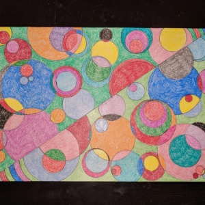 crayon art with a circle template, sharpies, and art paper
